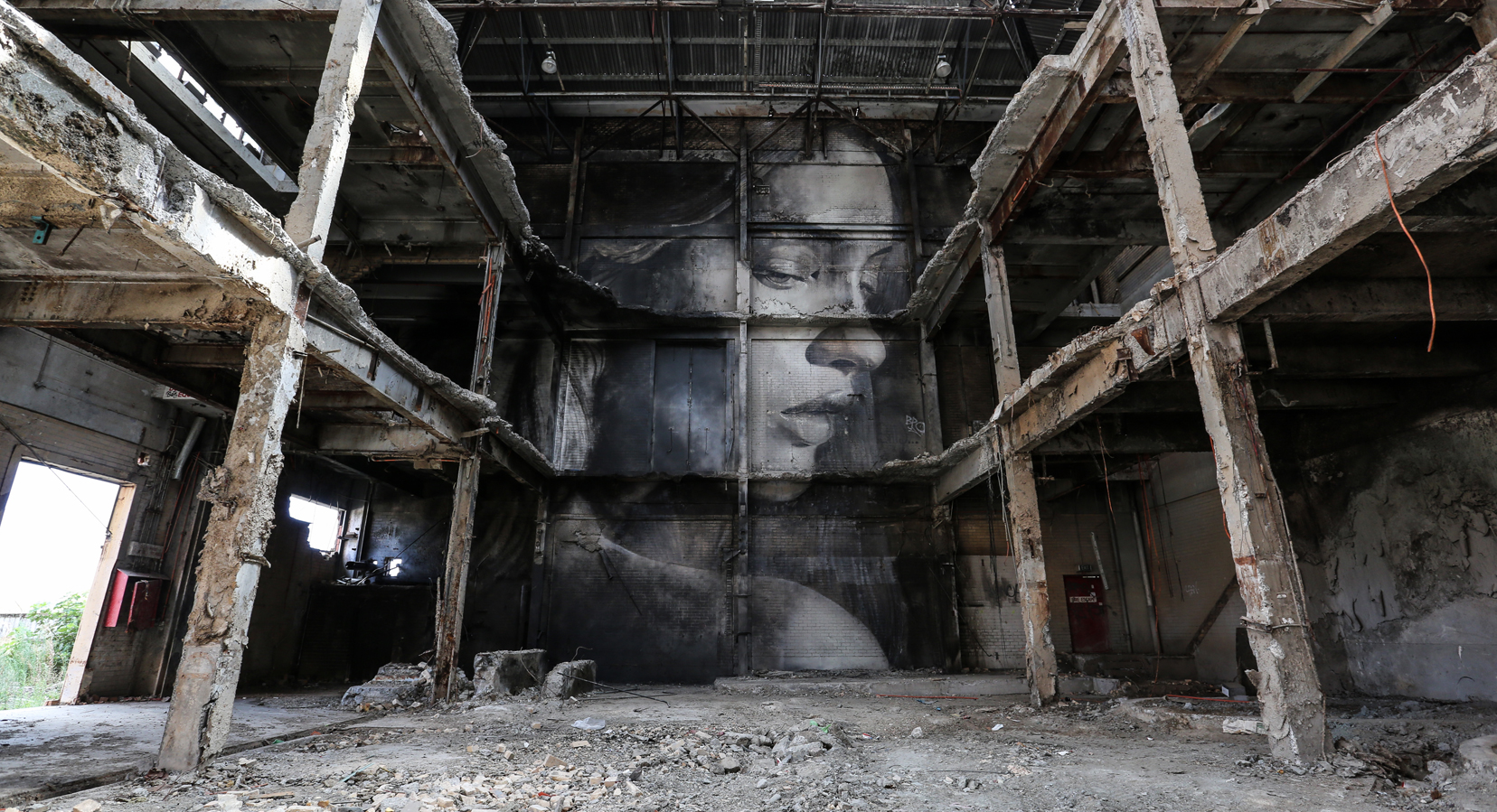 A Vision Amid Ruins: Artist Rone Paints Colossal Portraits of Women in Paper Mill