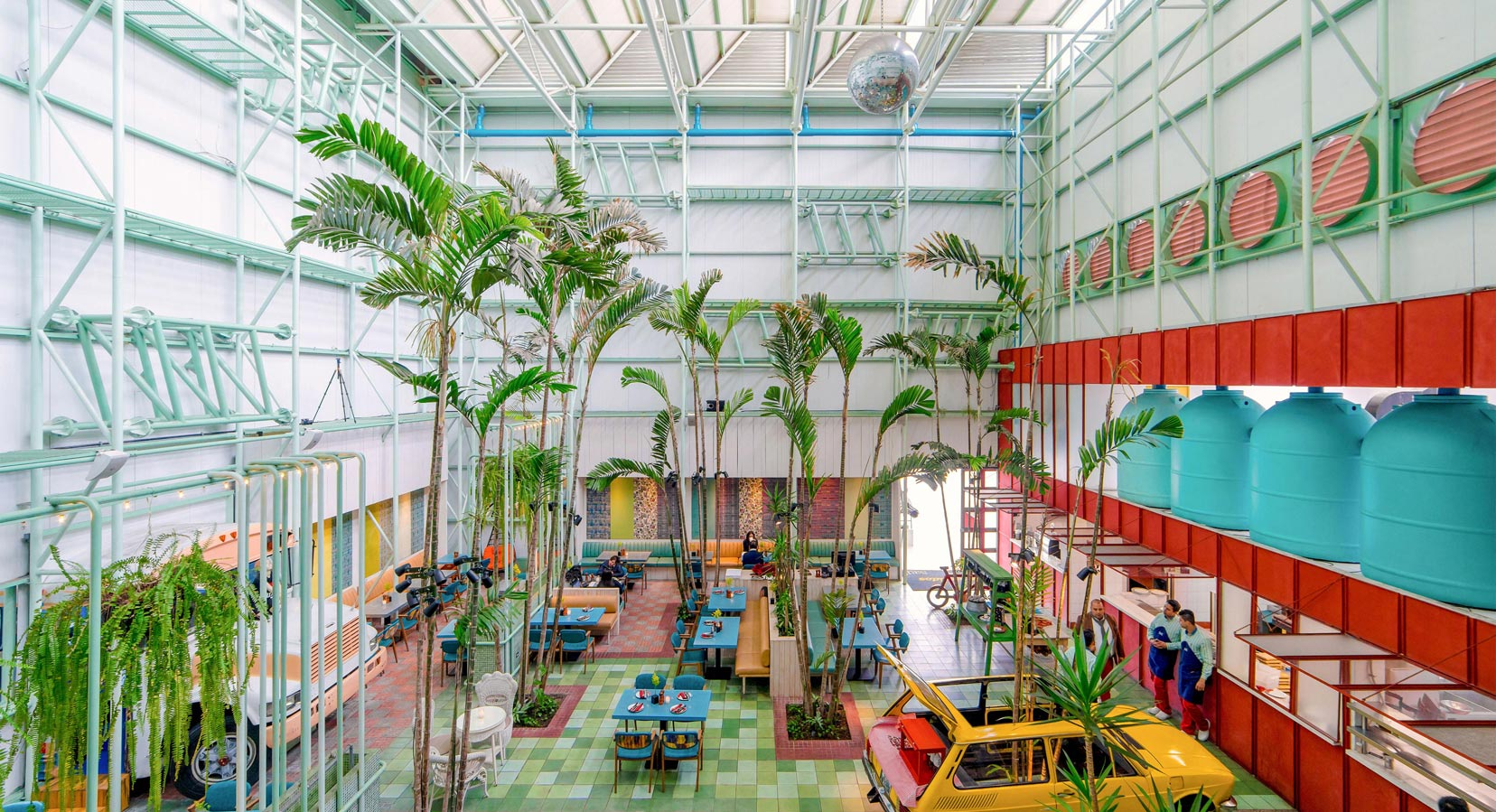 An Urban Oasis: Taller Ken Transforms Madero Café with Tropical Plants & Vintage Cars