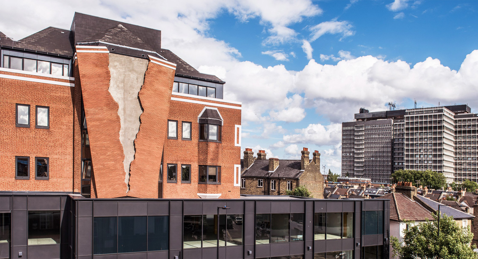 Alex Chinneck Creates A Giant Crack In The Brick Façade Of A London Building