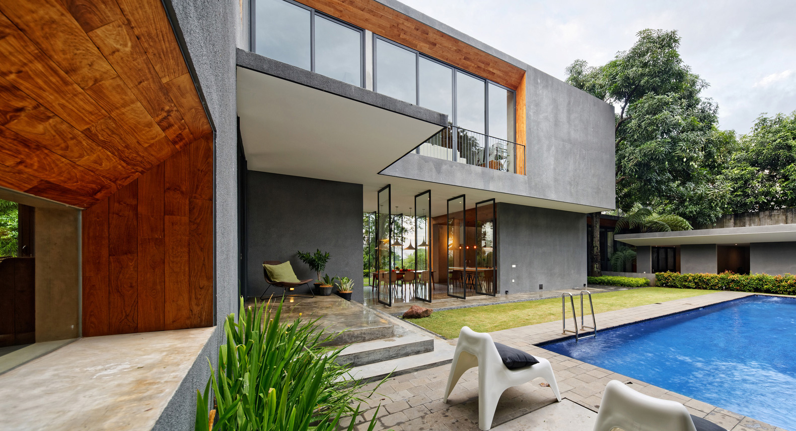 How A Mango Tree Inspired The Spectacular Inside Outside House ... Outside Of House Interior Design on outside front entry design, outside bathroom design, outside kitchen design, outside windows design, outside wedding design, outside floor design, outside garage design, outside door design, outside house design, outside basement design,
