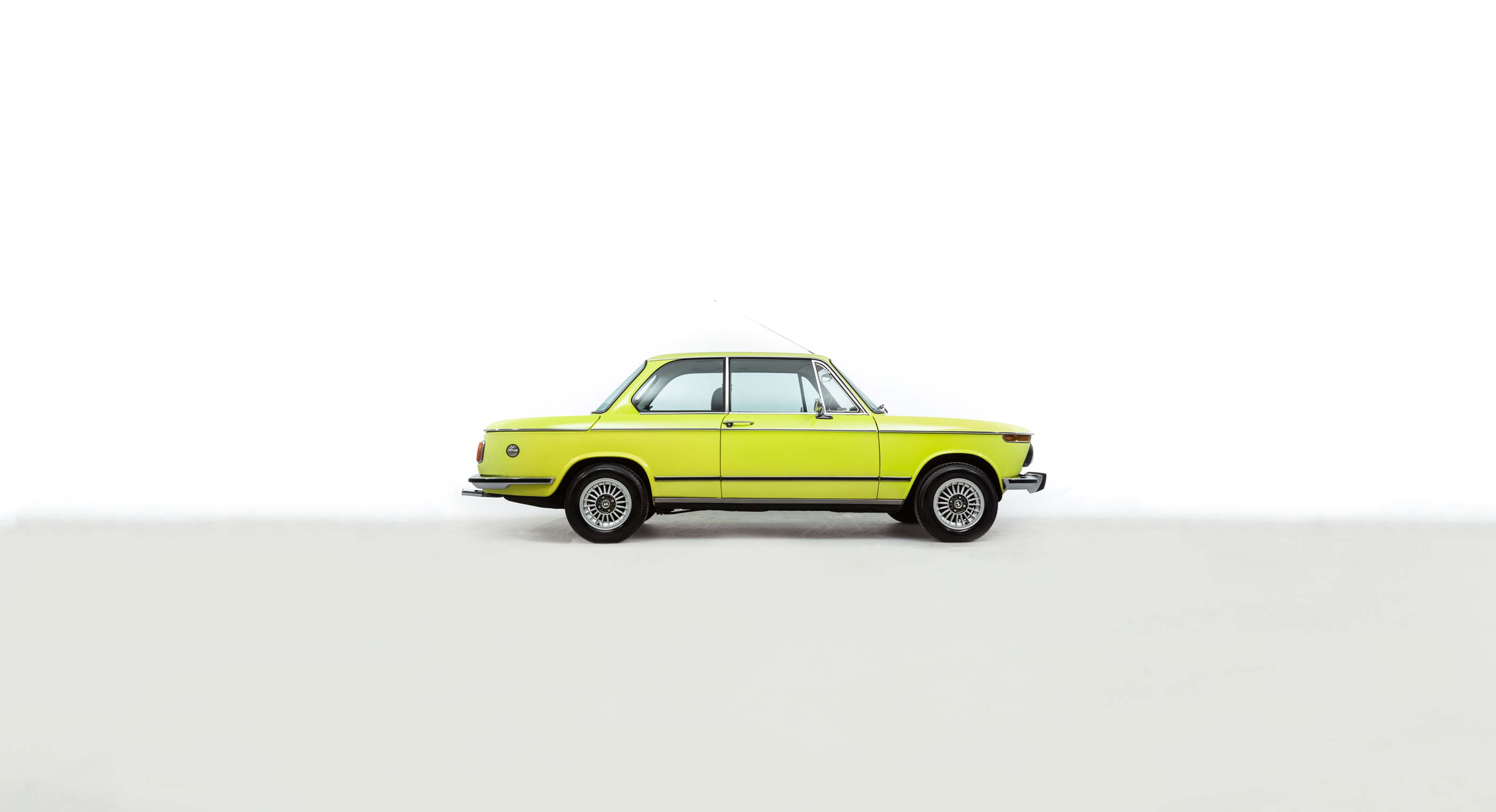 Why This Neon Yellow 1975 BMW 2002 tii Belongs In Your Garage