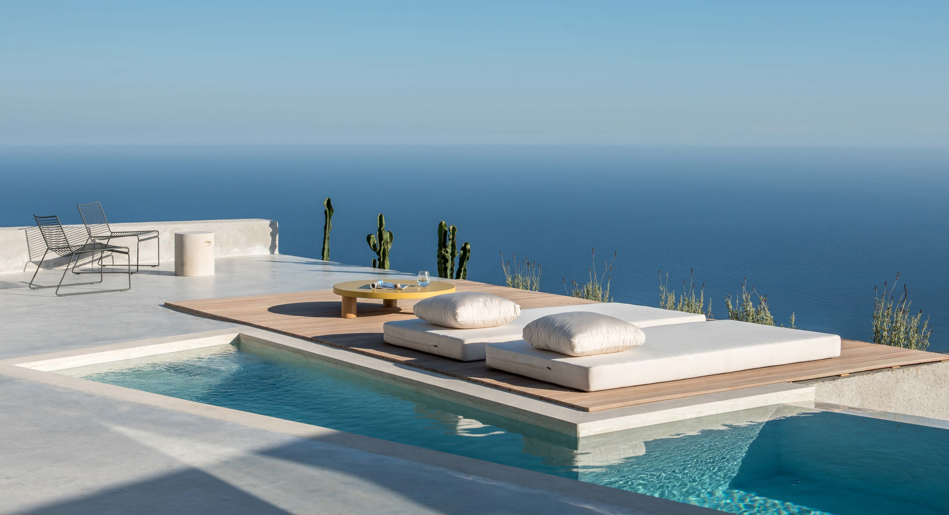 Nestled in Santorini's Mountainside: The Holiday Home of Dreams