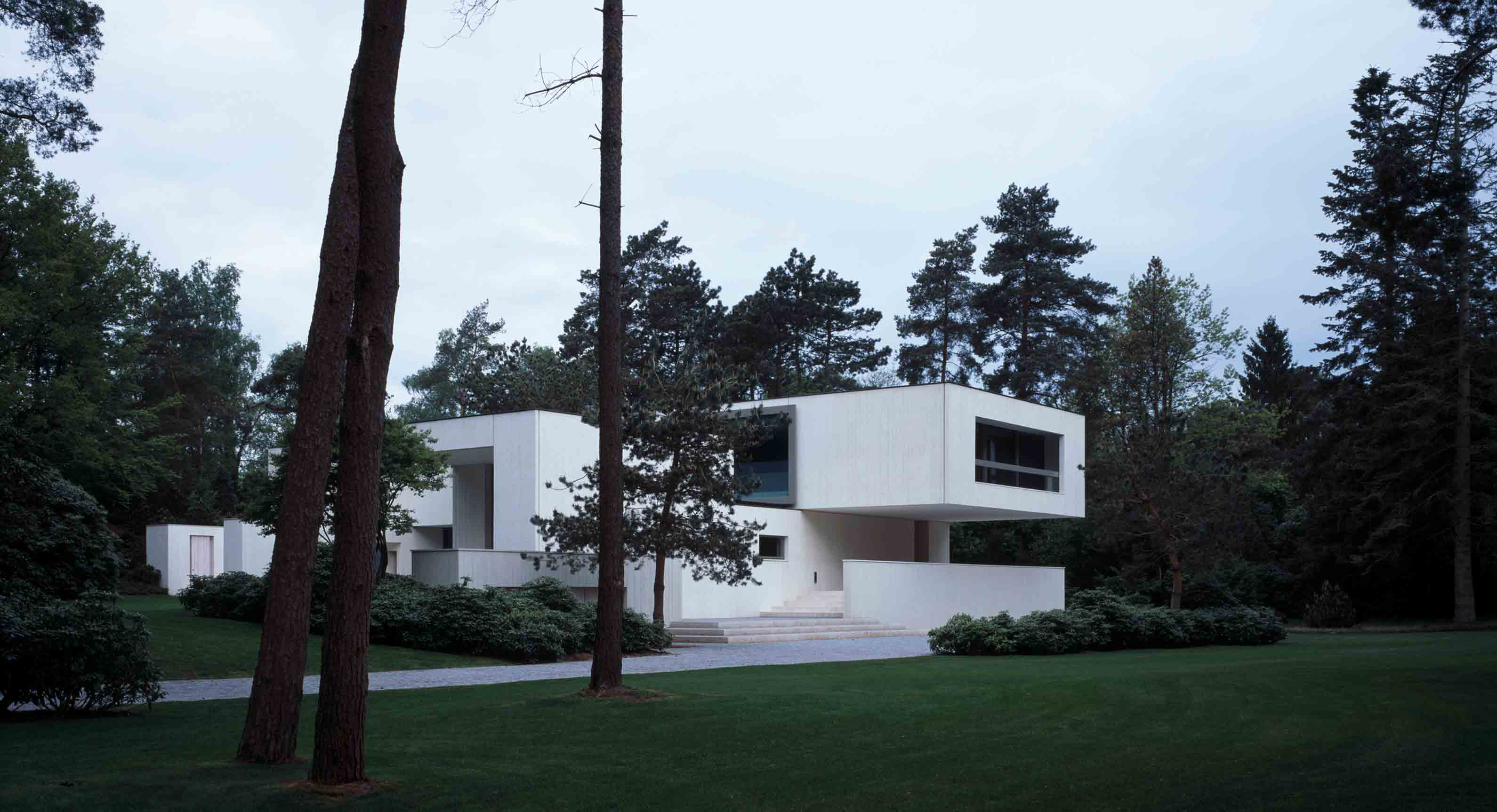 Villa Waalre: A Pared-Back Concrete Home In The Heart Of A Dutch Forest